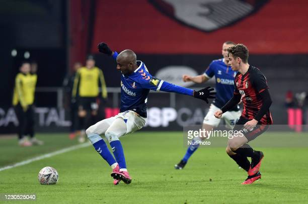 Oldham Athletic's Dylan Bahamboula tussles with Gavin Kilkenny of Bournemouth during the FA Cup match between Bournemouth and Oldham Athletic at the...