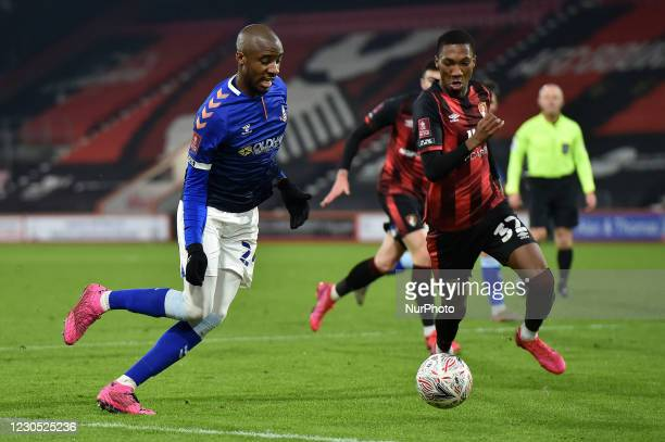 Oldham Athletic's Dylan Bahamboula tussles with Jaidon Anthony of Bournemouth during the FA Cup match between Bournemouth and Oldham Athletic at the...