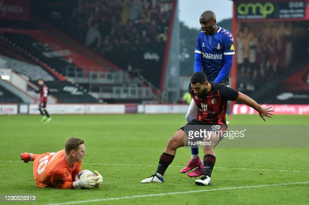 Oldham Athletic's Dylan Bahamboula tussles with Will Dennis of Bournemouth and Cameron Carter-Vickers of Bournemouth during the FA Cup match between...