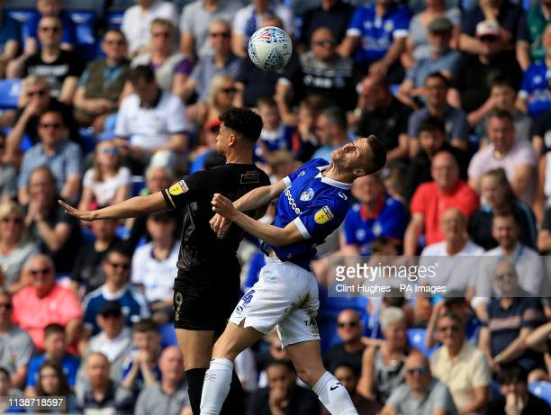 Oldham Athletic's George Edmundson and Mansfield Town's Tyler Walker contest a header during the Sky Bet League Two match at Boundary park Oldham