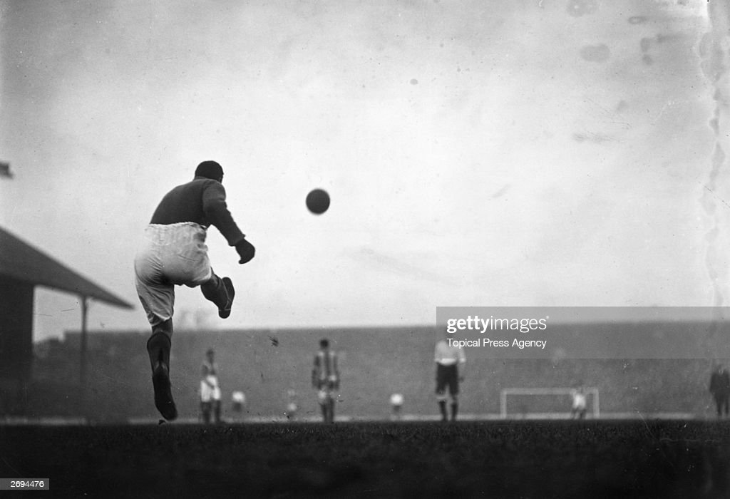 Oldham Athletic's goalkeeper taking a goal kick during a game against Tottenham Hotspur.