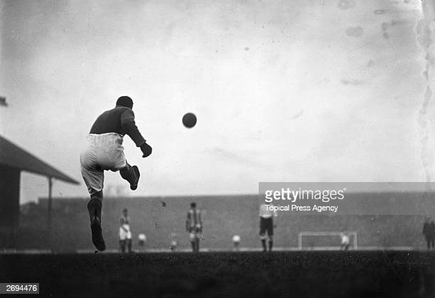 Oldham Athletic's goalkeeper taking a goal kick during a game against Tottenham Hotspur