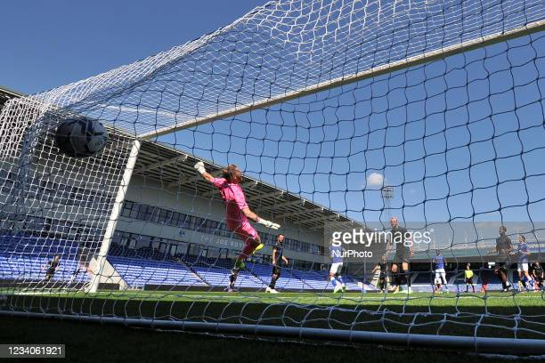 Oldham Athletic's Hallam Hope scores his sides first goal of the game during the pre season friendly match between Oldham Athletic and Wigan Athletic...