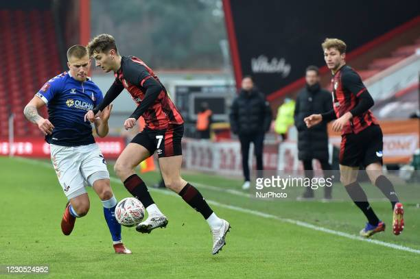 Oldham Athletic's Harry Clarke tussles with David Brooks of Bournemouth during the FA Cup match between Bournemouth and Oldham Athletic at the...