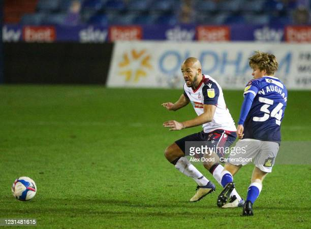 Oldham Athletic's Harry Vaughan plays a ball around Bolton Wanderers' Alex John-Baptiste during the Sky Bet League Two match between Oldham Athletic...