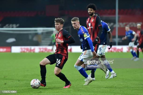 Oldham Athletic's Jordan Barnett tussles with Gavin Kilkenny of Bournemouth during the FA Cup match between Bournemouth and Oldham Athletic at the...