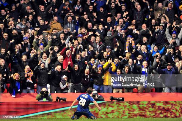 Oldham Athletic's Jose Baxter celebrates in front of the away fans after scoring his side's third goal