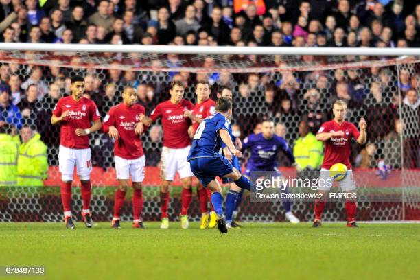 Oldham Athletic's Jose Baxter scores his side's third goal of the game