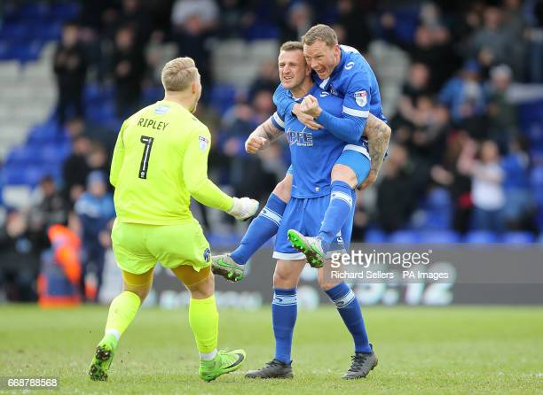 Oldham Athletic's Peter Clarke Connor Ripley and Brian Wilson celebrate after teammate Lee Erwin scores the first goal during the Sky Bet...