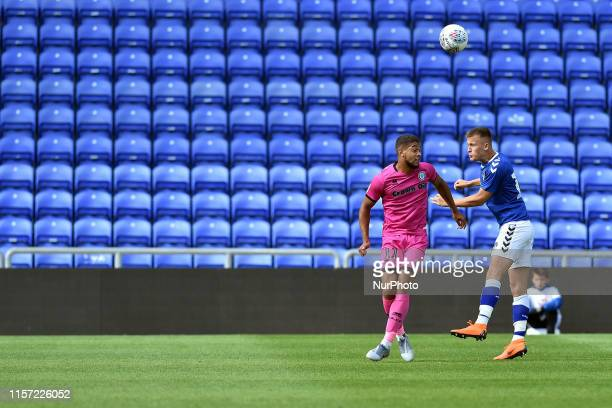 Oldham Athletic's Tom Hamer and Rochdale AFC's Rekeil Pyke in action during the Pre-season Friendly match between Oldham Athletic and Rochdale at...