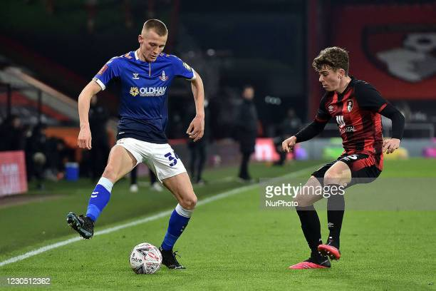 Oldham Athletic's Tom Hamer tussles with Gavin Kilkenny of Bournemouth l during the FA Cup match between Bournemouth and Oldham Athletic at the...