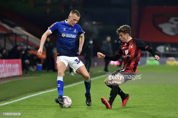 Oldham Athletic's Tom Hamer tussles with Gavin Kilkenny of Bournemouth during the FA Cup match between Bournemouth and Oldham Athletic at the...