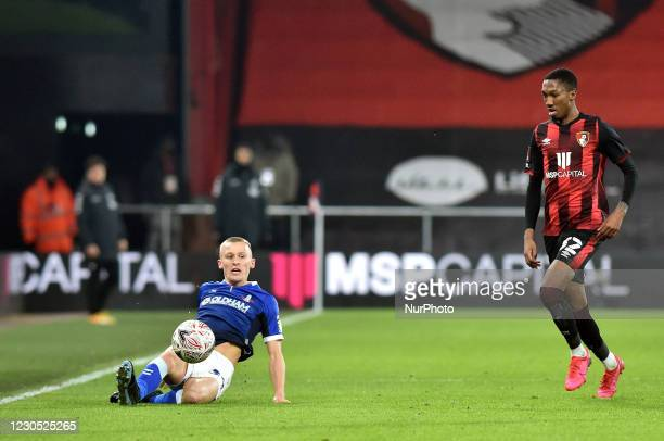 Oldham Athletic's Tom Hamer tussles with Jaidon Anthony of Bournemouth during the FA Cup match between Bournemouth and Oldham Athletic at the...