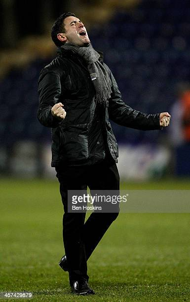 Oldham manager Lee Johnson celebrates his team's victory during the FA Cup Second Round Replay match between Mansfield Town and Oldham Athletic at...