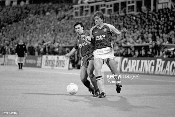 Oldham's Andy Holden and Aston Villa's Kent Nielsen tussle for the ball during the FA Cup sixth round tie at Boundary Park which Oldham won 30