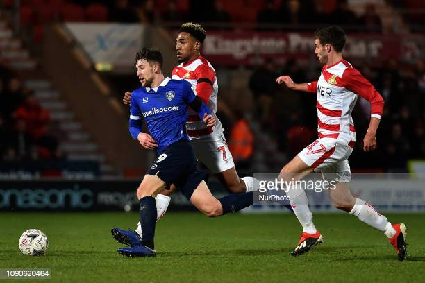 Oldham's Callum Lang and Doncaster's Matty Blair during the FA Cup match between Doncaster Rovers and Oldham Athletic at the Keepmoat Stadium,...