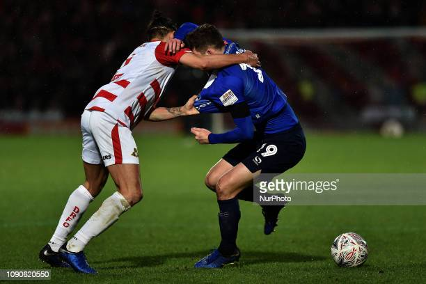 Oldham's Callum Lang and Doncaster's Niall Mason during the FA Cup match between Doncaster Rovers and Oldham Athletic at the Keepmoat Stadium,...