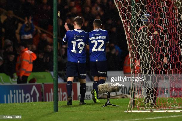 Oldham's Callum Lang and Johan Branger-Engone after the FA Cup match between Doncaster Rovers and Oldham Athletic at the Keepmoat Stadium, Doncaster...