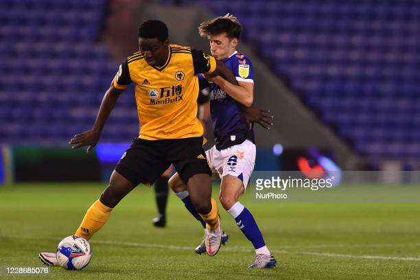 Oldham's Callum Whelan and Wolves Owen Otasowie during the EFL Trophy match between Oldham Athletic and Wolverhampton Wanderers at Boundary Park,...