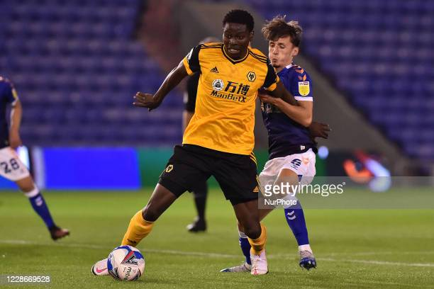 Oldham's Callum Whelan and Wolves Owen Otasowie in action during the EFL Trophy match between Oldham Athletic and Wolverhampton Wanderers at Boundary...