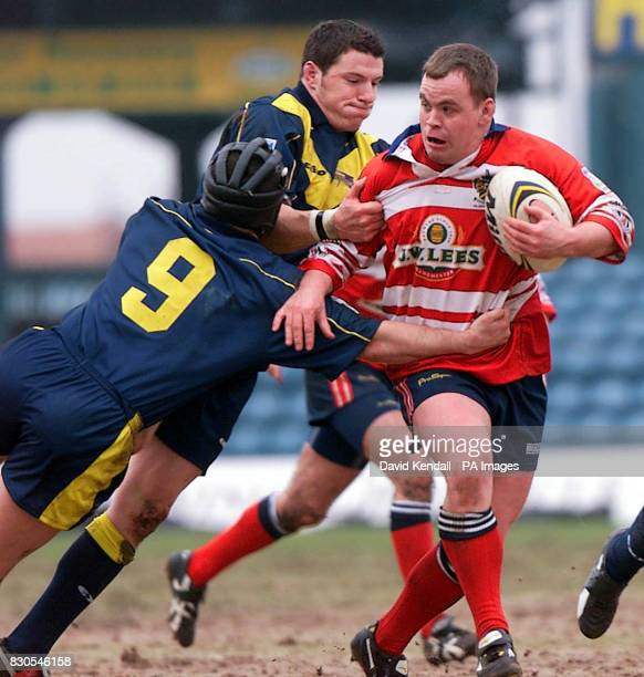 Oldham's John Hough is tackled by Gateshead's Roy Southernwood during the Northern Ford Premiership game at Boundary Park Oldham
