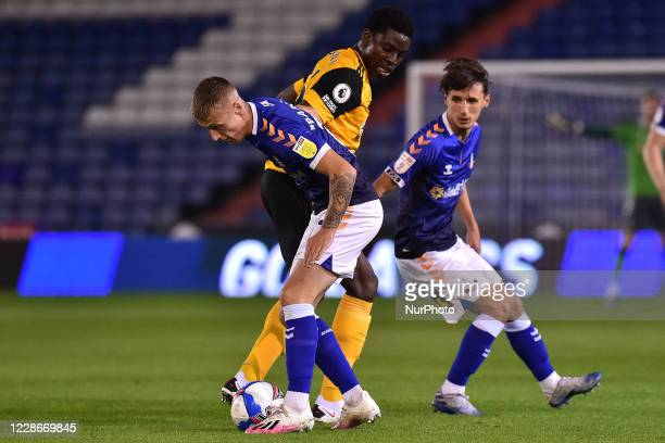Oldham's Jordan Barnett and Wolves Owen Otasowie in action during the EFL Trophy match between Oldham Athletic and Wolverhampton Wanderers at...