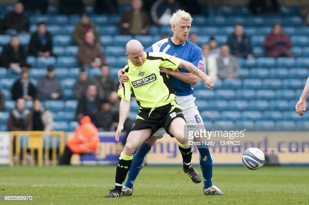 Oldham's Lee Hughes holds of Millwall's Zak Whitbread
