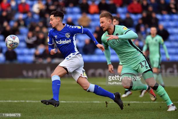 Oldham's Mohamed Maouche and Byron Webster of Carlisle United in action during the Sky Bet League 2 match between Oldham Athletic and Carlisle United...