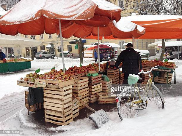 Oldman selling apples in freezing weather