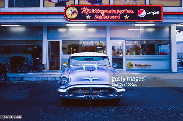 oldsmobile at chicken place - einar orn stock pictures, royalty-free photos & images