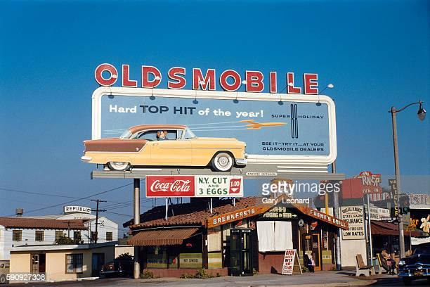 Oldsmobile Super 88 Holiday Hardtop Sedan Billboard above The Corner Diner and next to Republic Pictures at Ventura Radford in Studio City in 1957 in...