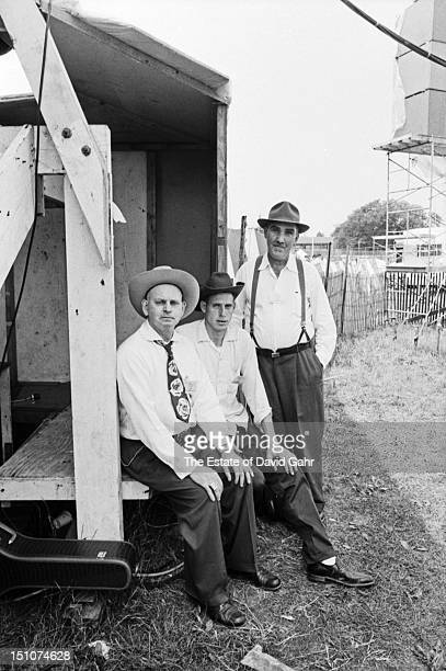 Oldtiime fiddlers and country musicians Dewey Shepherd OC Shepherd and Gaither Carlton backstage at the Newport Folk Festival in July 1964 in Newport...