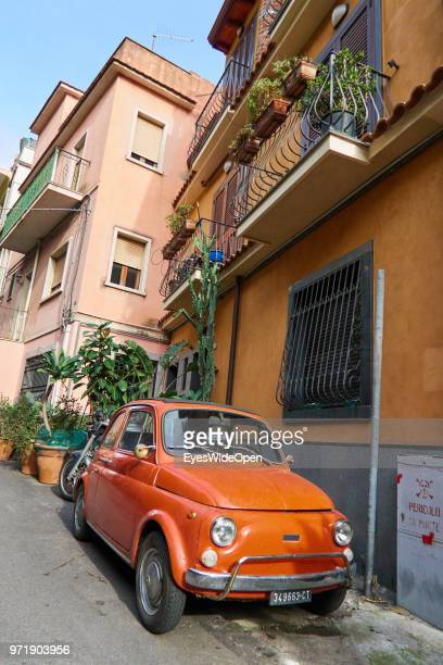 Oldtimer car Fiat 500 Cinquecento is parking in the narrow streets on April 8 2018 in Taormina Sicily Italy