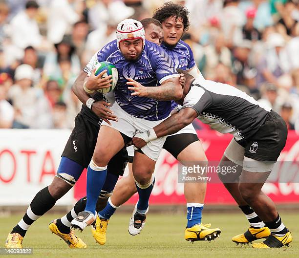 Ole Avei of Samoa runs with the ball during the IRB Pacific Nations Cup match between Fiji and Samoa at Prince Chichibu Memorial Stadium on June 10...