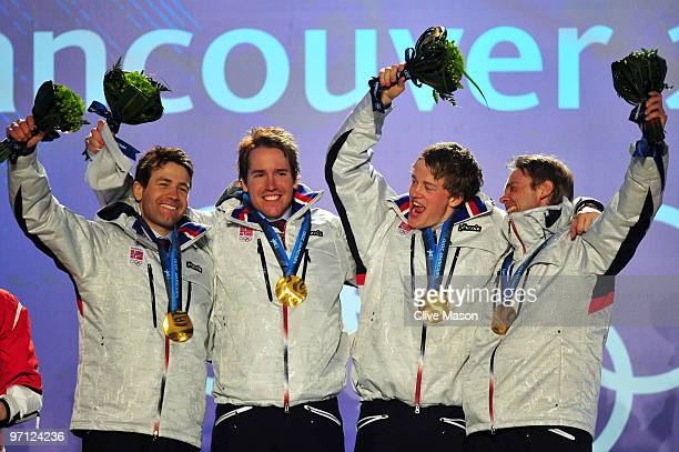 Ole Einar Bjoerndalen Emil Hegle Svendsen Tarjei Boe and Halvard Hanevold of Norway celebrate winning the gold medal during the medal ceremony for...