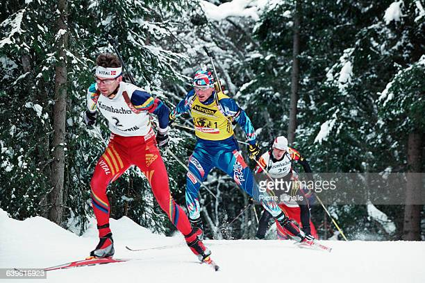 Ole Einar Bjoerndalen of Norway and Rapahel Poiree of France during the 15km World Cup Mass Start