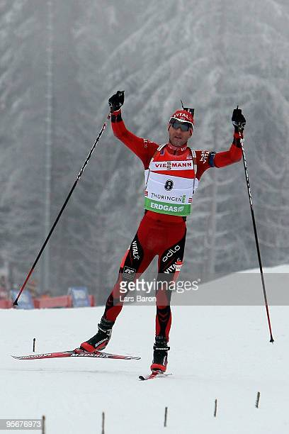 Ole Einar Bjoerndalen of Norway celebrates after winning the Men's 15 km mass start in the e.on Ruhrgas IBU Biathlon World Cup on January 10, 2010 in...