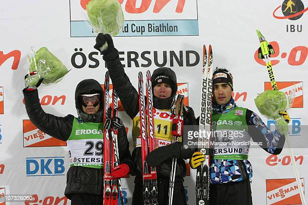 Ole Einar Bjoerndalen of Norway celebrates with Emil Hegle Svendsen of Norway and Martin Fourcade of France after the men's sprint during the IBU...