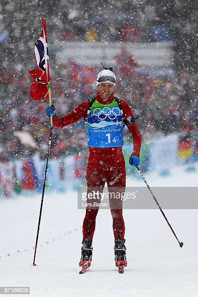 Ole Einar Bjoerndalen of Norway crosses the finish line to win the gold medal in the men's 4 x 75 km biathlon relay on day 15 of the 2010 Vancouver...