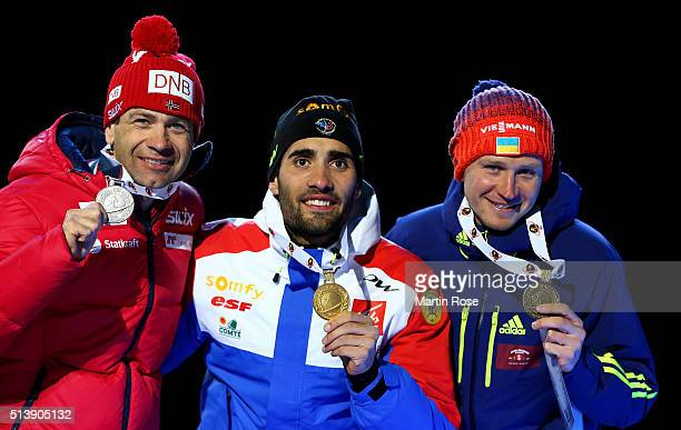 Ole Einar Bjoerndalen of Norway Martin Fourcade of France and Sergey Semenov of Ukraine celebrate their medal in the men's 10km sprint during day...