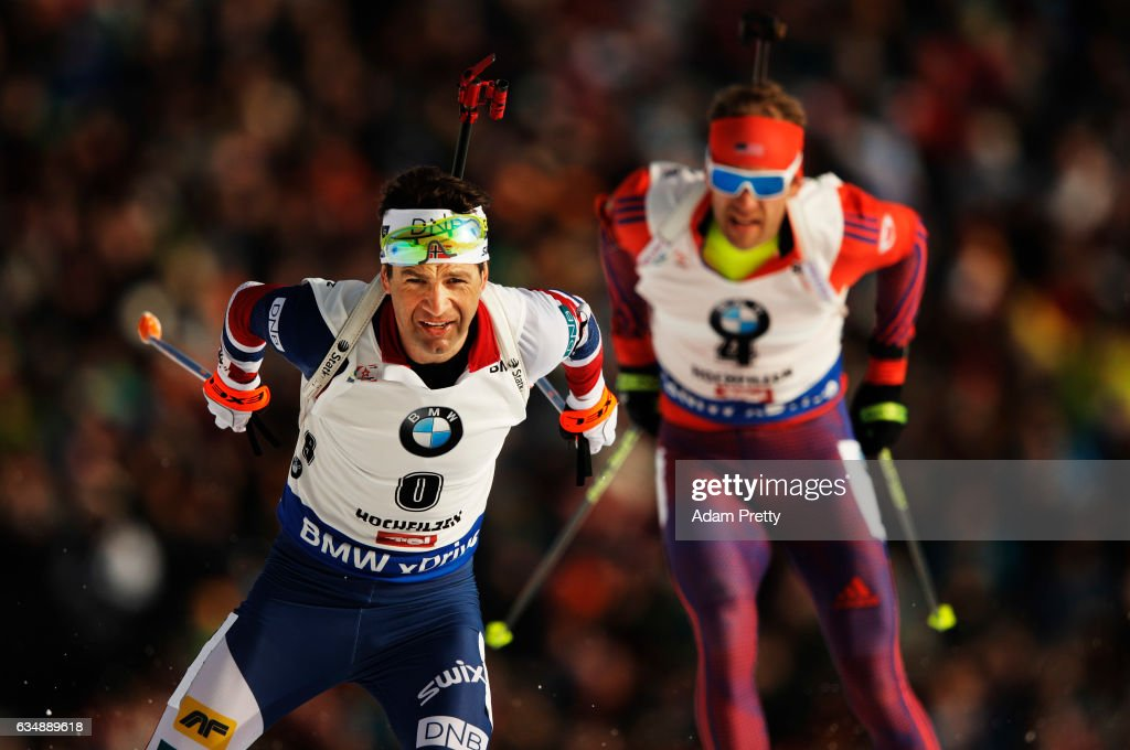 Ole Einar Bjoerndalen of Norway passes Lowell Bailey of the USA on his way to winning bronze in the Men's 12.5km pursuit competition of the IBU World Championships Biathlon 2017 at the Biathlon Stadium Hochfilzen on February 12, 2017 in Hochfilzen, Austria.