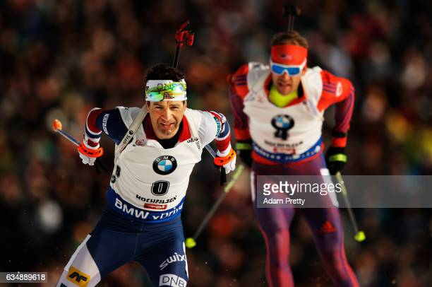 Ole Einar Bjoerndalen of Norway passes Lowell Bailey of the USA on his way to winning bronze in the Men's 125km pursuit competition of the IBU World...