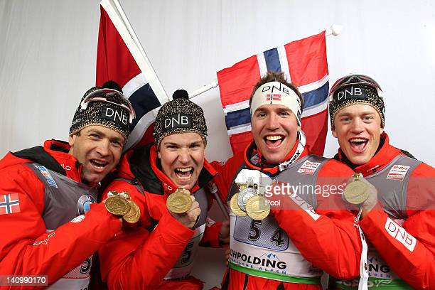 Ole Einar Bjoerndalen Rune Brattsveen Tarjei Boe and Emil Hegle Svendsen of Norway show their gold medal for the Men's 4 x 75km Relay during the IBU...