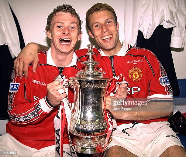 Ole Gunnar Solskjaer and Ronny Johnson of Manchester United celebrate in the dressing room with the FA Cup after the FA Cup Final between Manchester...