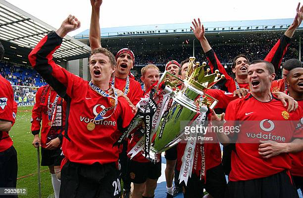Ole Gunnar Solskjaer and Roy Keane celebrate with the Barclaycard Premiership trophy after the FA Barclaycard Premiership match between Everton v...