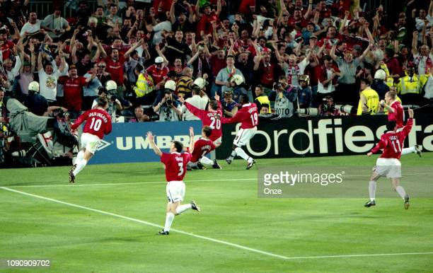 Ole Gunnar Solskjaer celebrates with team mates his side's second goal during the UEFA Champions league final match between Manchester United and...