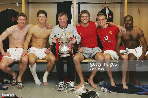 Ole Gunnar Solskjaer Cristiano Ronaldo Sir Alex Ferguson Roy Carroll Darren Fletcher and Eric DjembaDjemba celebrate with the FA Cup in the dressing...