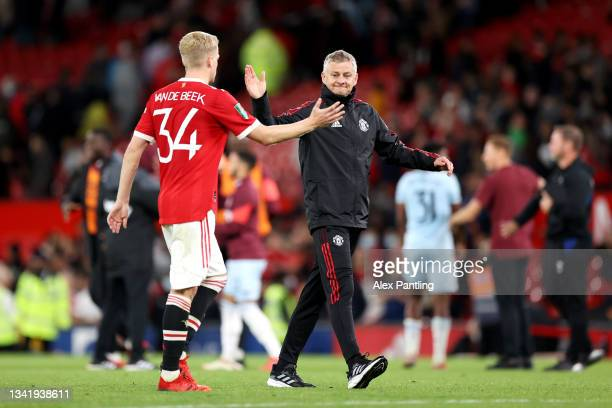Ole Gunnar Solskjaer embraces Donny van de Beek of Manchester United after the Carabao Cup Third Round match between Manchester United and West Ham...
