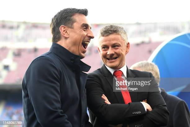 Ole Gunnar Solskjaer Interim Manager of Manchester United and Gary Neville ahead of the UEFA Champions League Quarter Final second leg match between...