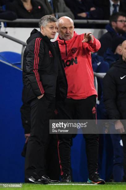 Ole Gunnar Solskjaer Interim Manager of Manchester United and Mike Phelan look on during the Premier League match between Cardiff City and Manchester...